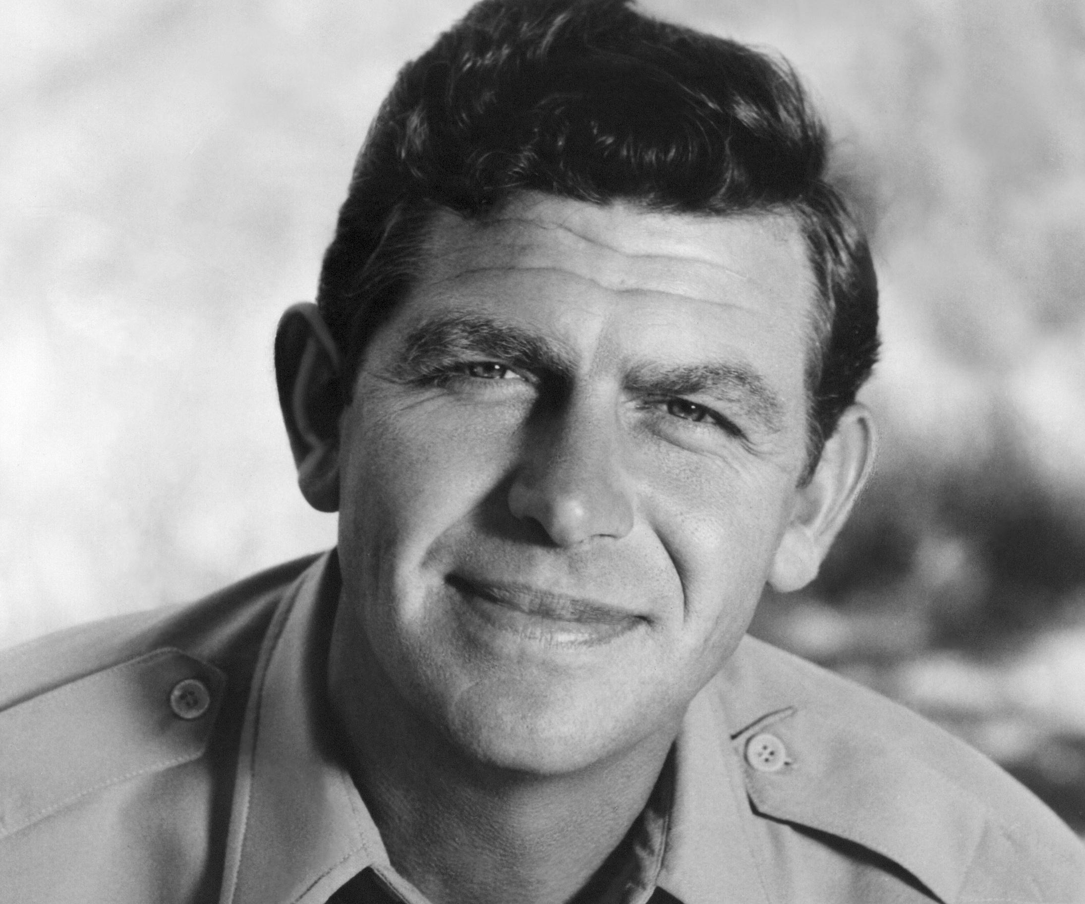 andy griffith Beginning in september 1960, griffith starred as sheriff andy taylor in the andy griffith show for the cbs television networkthe show took place in the fictional town of mayberry, north carolina, where taylor, a widower, was the sheriff and town sagethe show was filmed at desilu studios, with exteriors filmed at forty acres in culver city, california.